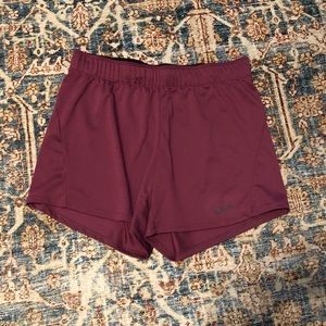Dark pink dri-fit Nike shorts